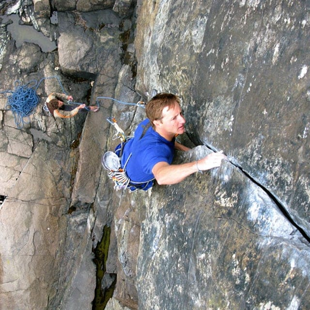 Jared Ogden climbing A Dare By The Sea in Acadia National Park, Maine. Photo by Mark Synnott.