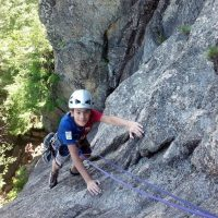 Family rock climbing on Upper Refuse at Cathedral Ledge, New Hampshire.