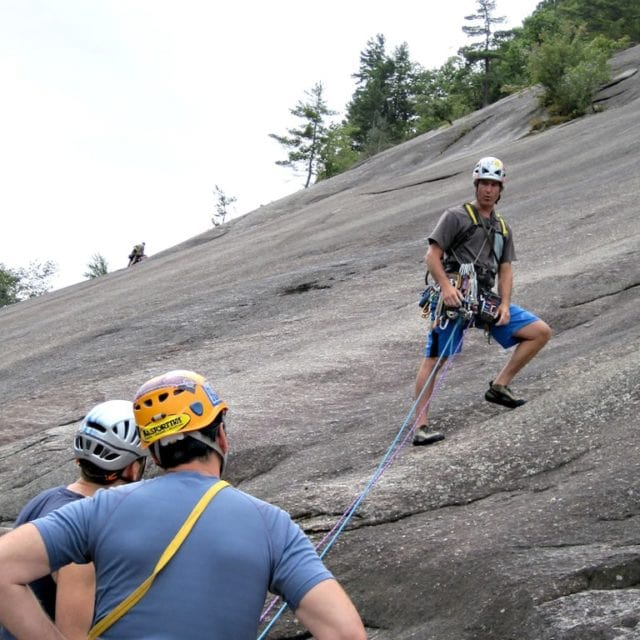 Mark Synnott teaching lead rock climbing. Standard Route on Whitehorse Ledge, New Hampshire.
