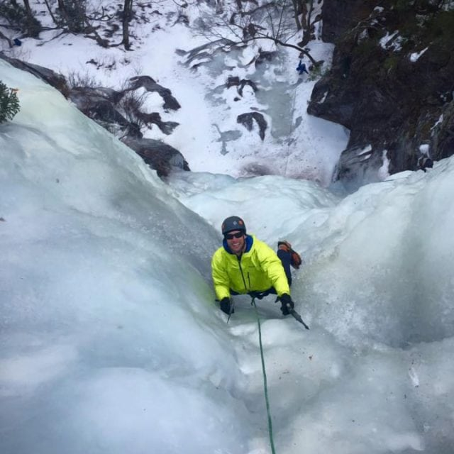 Guided ice climbing on Dracula at Frankenstein Cliffs in Crawford Notch, New Hampshire.