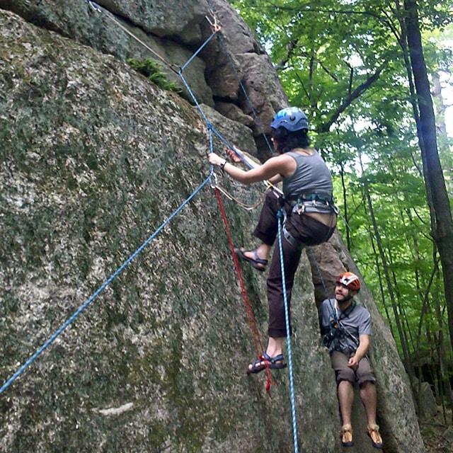 Practicing climbing self rescue techniques at Cathedral Ledge near North Conway, New Hampshire.